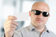 Businessman holding a blank business card. Royalty Free Stock Photo