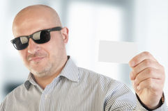 Businessman holding a blank business card. Royalty Free Stock Images