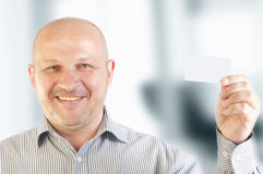 Businessman holding a blank business card Stock Images