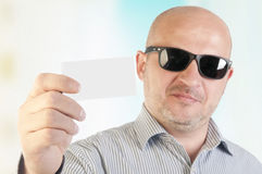 Businessman holding a blank business card. Royalty Free Stock Image