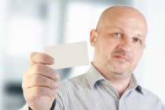 Businessman holding a blank business card Royalty Free Stock Images