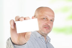 Businessman holding a blank business card Stock Photo