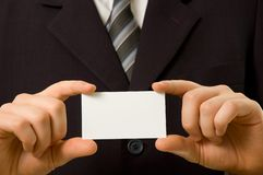 Businessman holding blank business card. With both hands Royalty Free Stock Photos