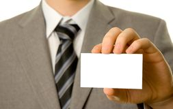 Businessman holding blank business card Royalty Free Stock Images