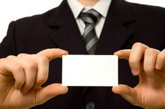 Businessman holding blank business card. With both hands Stock Image