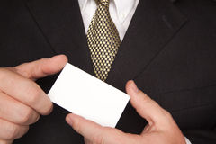 Businessman Holding Blank Business Card Stock Image