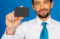 Businessman holding blank businesscard Stock Photography