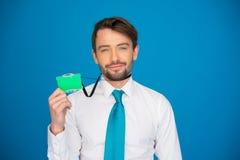 Businessman holding blank businesscard Stock Photo