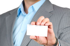 Businessman holding blank card Stock Images