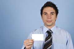 Businessman holding a blank card Stock Photos
