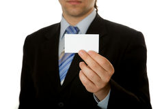 Businessman holding blank card. Isolated over white background Royalty Free Stock Image