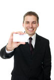 Businessman holding blank card Stock Photos
