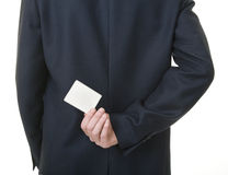 Businessman holding blank card behind his back Royalty Free Stock Photos