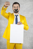 Businessman holding a blank card, calls for revolution Royalty Free Stock Photo