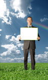 Businessman holding blank card outdoors Stock Images