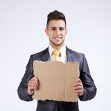 Businessman holding a blank cardboard Royalty Free Stock Photography