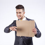 Businessman holding a blank cardboard Royalty Free Stock Photos