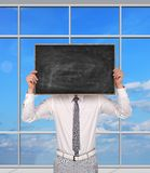 Businessman holding blank chalk board Royalty Free Stock Photography