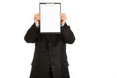 Businessman holding blank clipboard Royalty Free Stock Photography