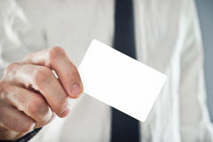 Businessman holding blank credit card Royalty Free Stock Photography
