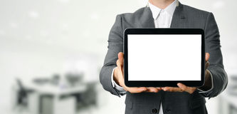 Businessman holding blank digital tablet with copy space Royalty Free Stock Photo