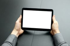 Businessman holding blank digital tablet Royalty Free Stock Photo