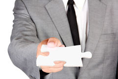 Businessman holding blank jigsaw Stock Photos
