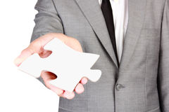 Businessman holding blank jigsaw Royalty Free Stock Photo