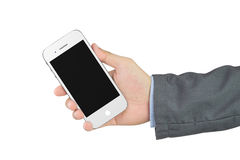 Businessman holding blank mobile phone with clipping path Royalty Free Stock Photos