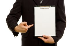 Businessman holding a blank notepad Royalty Free Stock Images