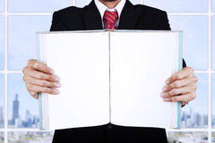 Businessman holding blank open book at office Royalty Free Stock Photo