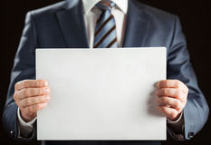Businessman holding blank paper Royalty Free Stock Photography