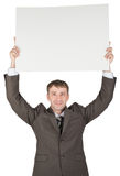 Businessman holding blank paper above his head Royalty Free Stock Images