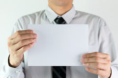Businessman holding a blank paper Stock Image