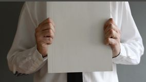 Businessman holding blank paper with copy space Royalty Free Stock Photos