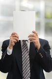 Businessman holding a blank paper Stock Photos