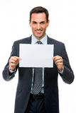 Businessman holding a blank paper Royalty Free Stock Images
