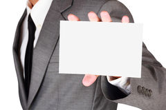 Businessman holding blank paper Royalty Free Stock Image