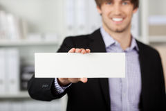 Businessman Holding Blank Paper In Office Stock Photography