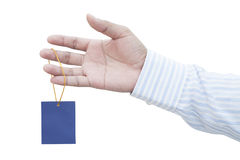 Businessman holding blank paper price tag Royalty Free Stock Photography