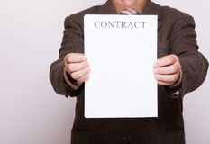 Businessman holding blank paper with sign contract Stock Photos