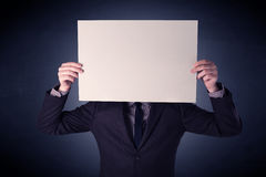 Businessman holding blank paper Stock Image