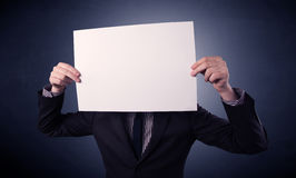 Businessman holding blank paper Royalty Free Stock Photos