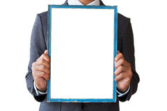 Businessman holding blank picture frame Royalty Free Stock Photography