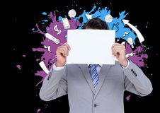 Businessman holding a blank placard in front of his face against various graphic icons Royalty Free Stock Photography