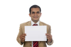 Businessman holding a blank placard. Royalty Free Stock Photo