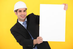 Businessman holding a blank poster Royalty Free Stock Image