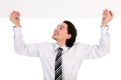Free Businessman Holding Blank Poster Royalty Free Stock Photos - 4821188