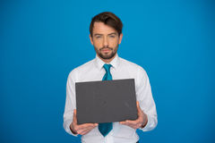 Businessman holding blank poster Royalty Free Stock Photo