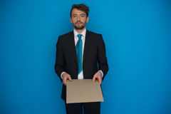 Businessman holding blank poster Stock Photography